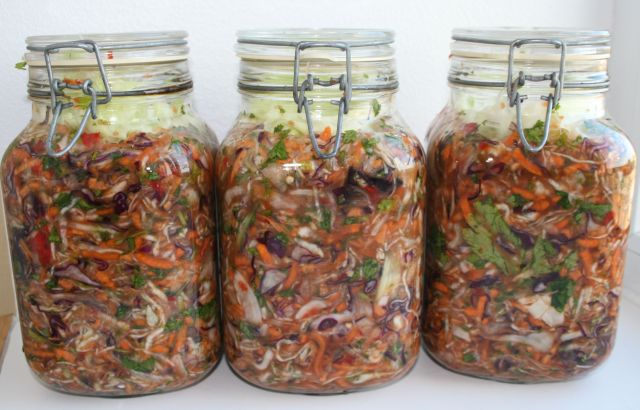 Jars filled with fresh vegetables