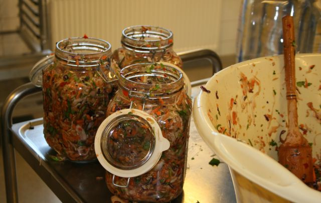 Vegetable mix packed into jars